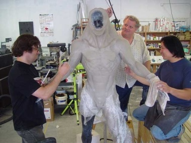 Norman Cabrera, Don Lanning and Steve Wang work on the full body sculpture.