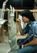 Steve Wang sculpts the Hunter's arm.