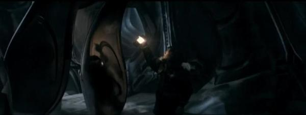 Kate analyzes one of the pods in a deleted sequence of the film.