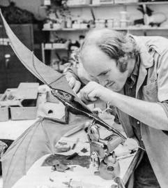 In construction phase, Tippett attaches the wing membranes to one of the 'flying' Vermithrax models.