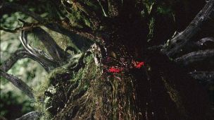 A close-up of the Man-Thing with the digitally enhanced eyes.