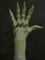 The hand sculpture.