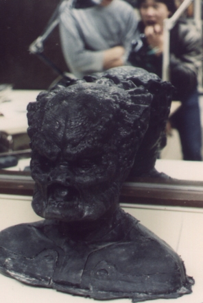 Black fiberglass cast of the Predator's head; the mandibles were sculpted and moulded separately.