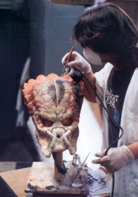 Matt Rose paints a Predator head. Notice the 'Twilight Zone' T-shirt!