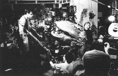 Brian Henson puppeteers Audrey II.