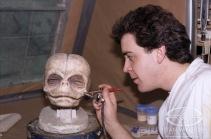 Woodruff paints the fetus' head.