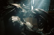 An insert head wrestles with a Predator. Aliens are truly dread, man. Truly dread.