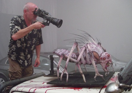 Darabont films one of the spider creature puppets.